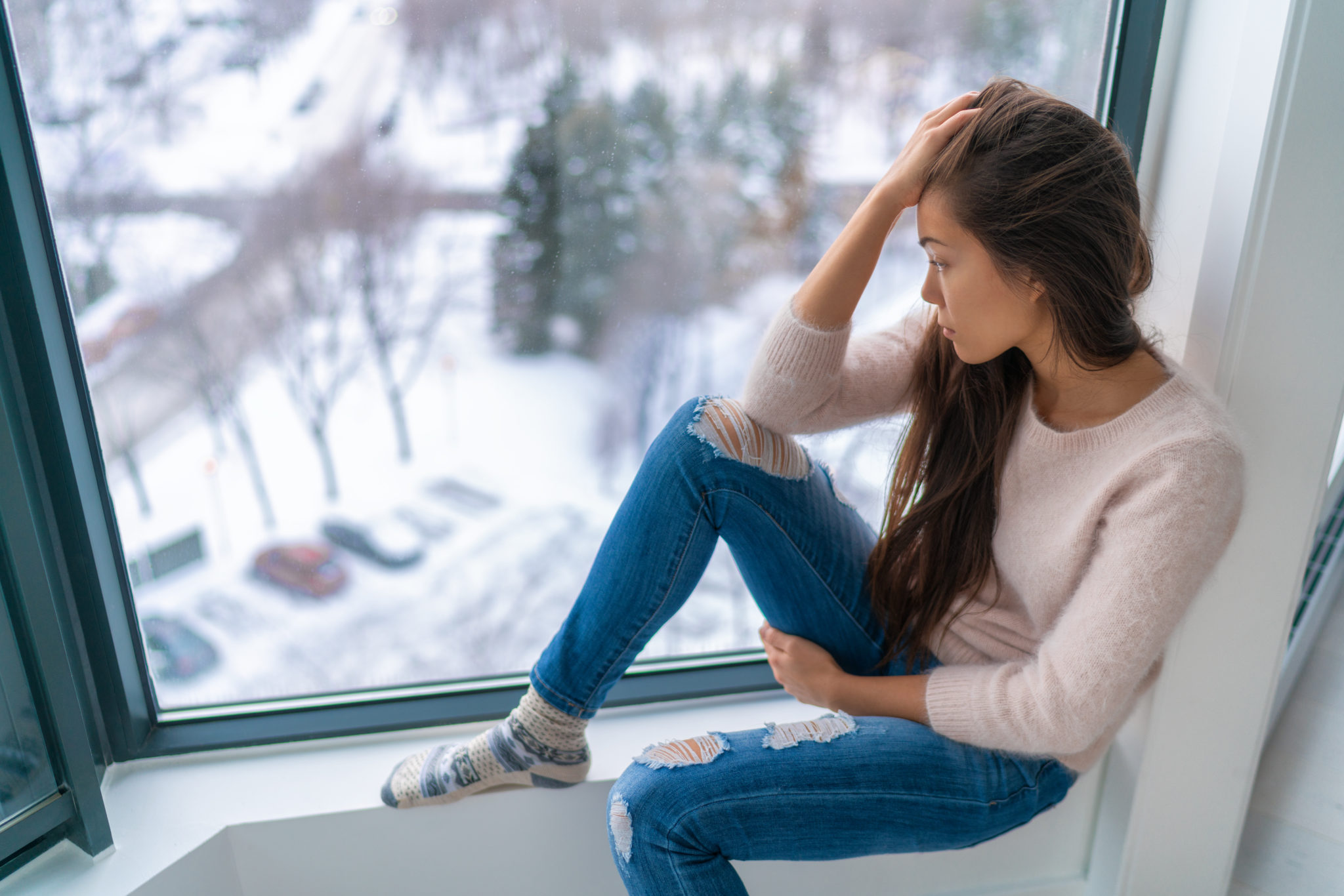 Winter Depressed Sad Girl Lonely By Home Window Looking At Cold Weather Upset Unhappy Bad Feelings Stress Anxiety Grief Emotions Asian Woman Portrait Tms Center At Southeastern Psychiatric Associates